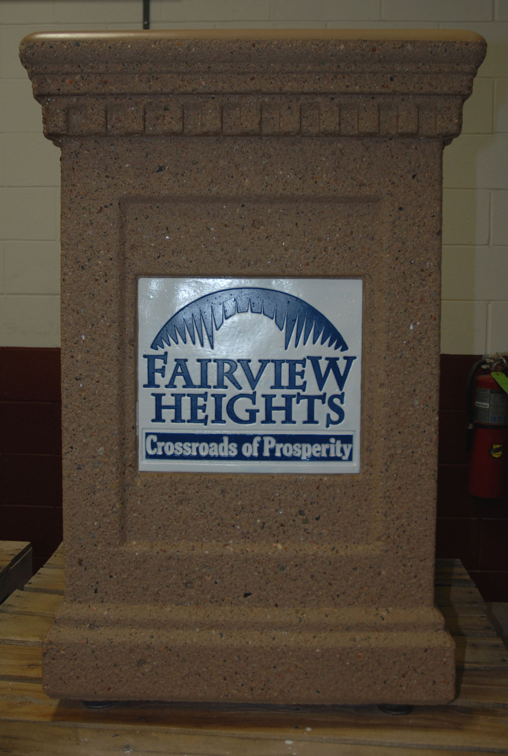 "Waste container with the words on it ""Fairview Heights, Crossroads of Prosperity."""